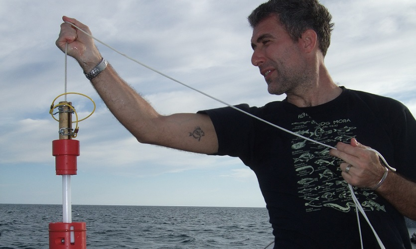 Prof Mariani samples seawater in the Mediterranean