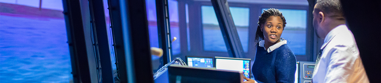 Maritime student using the 360 degree ship simulator.