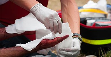 Image of hands administering first aid