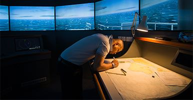 Image of a man working in a ship simulator