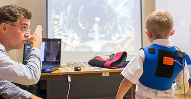 Boy playing virtual game