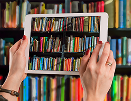 Image of an ipad taking a photo of some books