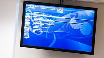 Image of a TV screen displaying PC availability
