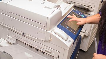 Close up of a student using a printer