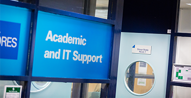 Windows to a room with the LJMU logo on them saying Academic and IT Support