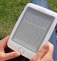 Image of a person holding an electronic book reader