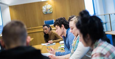 Students sitting in the LJMU mooting room