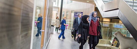 Image of students walking through the Redmonds Building