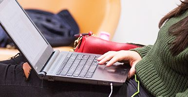 Shot of a woman working on a laptop