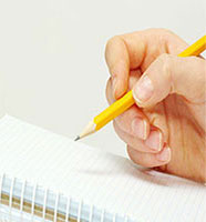 Hand holding a pen